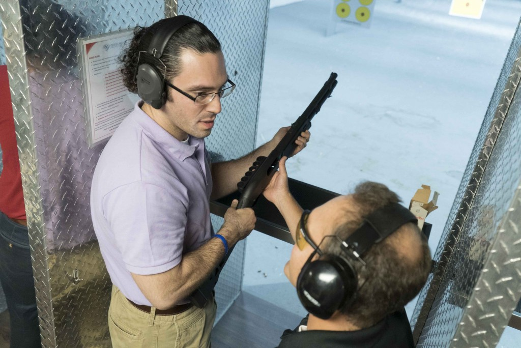 """SPJ President Mike Savino gets instruction from Chad Nye, Keene State journalism professor, during the Connecticut SPJ sponsored event, """"Journalism on Target"""" held at the Greyson Guns firing range in Orange, Conn. Aug. 22, 2016. 